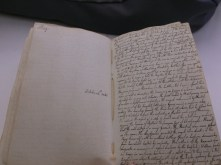 The notebook by Richard Arkwright(III) open on the page which describes the Battle of Hastings