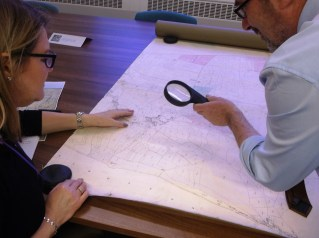 Staff from DCC Legal Services team inspecting the Eyam tithe map of 1842