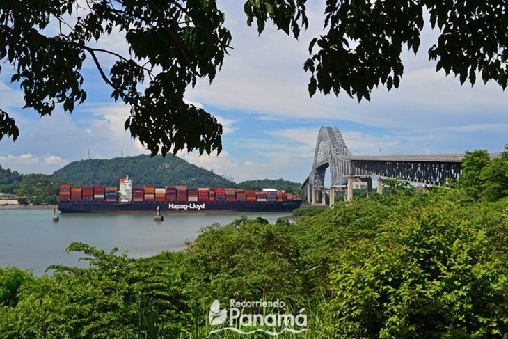 View of the Neopanamax ship passing under the Bridge of the Americas