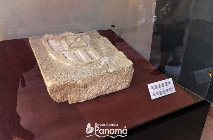 Stone with a carved shield at La Merced Museum