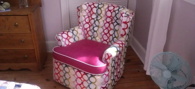 Child's armchair reupholstered in custom fabric