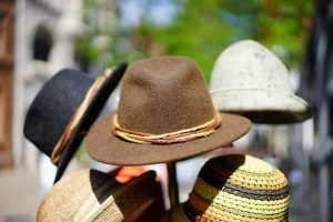 Picture showing many hats on a hat rack.