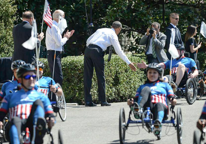 Obama with US soldiers on recumbent trikes