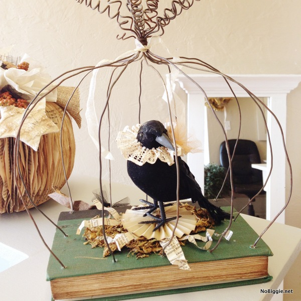 Vintage style book and wire pumpkin decoration