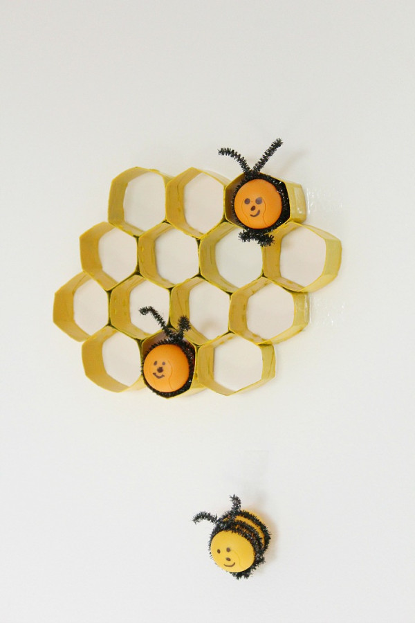 Recycled plastic egg bee decoration with honey comb display