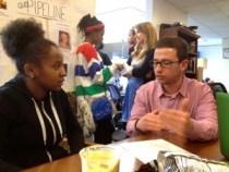 Maryland journalism student Louie Dane mentors a Critical Exposure participant.