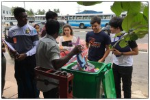 DP Geography students at the Pelawatte scrap dealer weighing mixed paper.