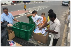 Grade 5 students unloading paper at the Pelawatte scrap dealer.