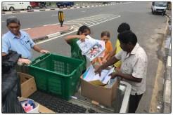 Grade 5 students unloading paper at the Pelawatte scrap dealer.