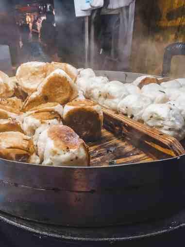 fried pork buns at night market in taiwan