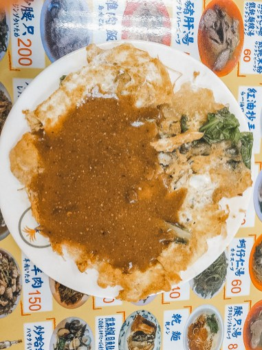 oyster omelette at shilin night market in taipei taiwan