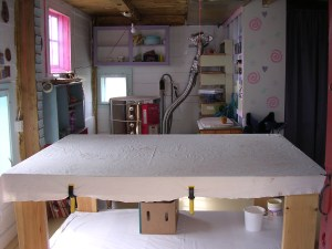 Inside of the studio I have a big table my husband built for me to do my hand-built pottery.