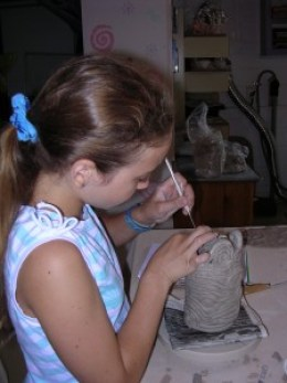 My older daughter during one of the first summers of Clay Play Studio Art Camp.