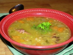 A bowl of split pea soup with ham