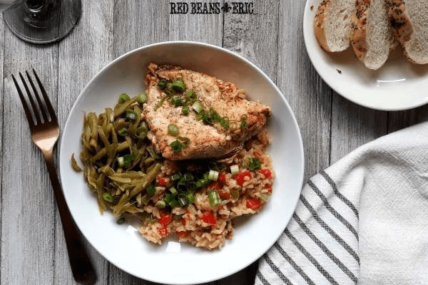 Plate of Cajun Seasoned Chicken and Rice with bread