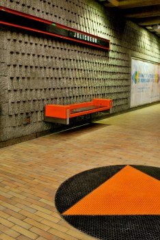 Orange bench and floor tiles at Jolicoeur metro