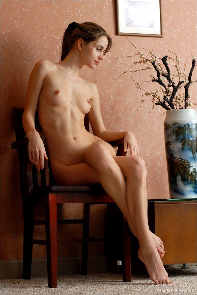 Anya posing on chair  RedBust