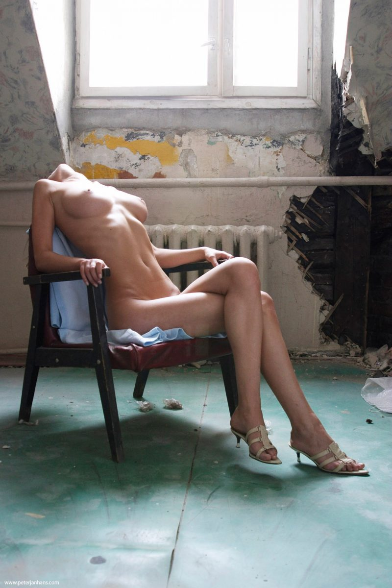 Kristina posing nude in a chair  RedBust