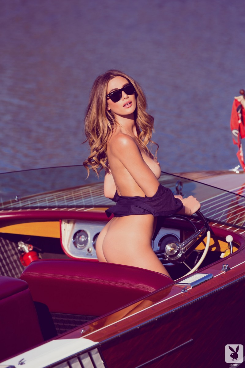 Maggie May in motorboat  RedBust