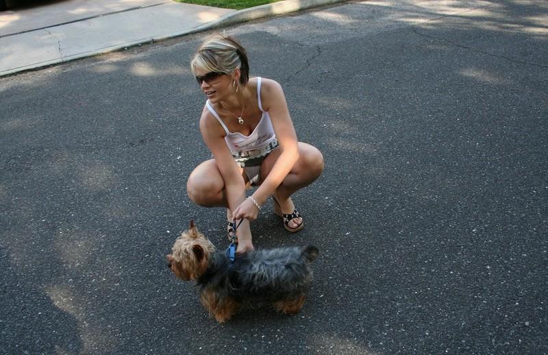 Ann Angel walking with dog  RedBust