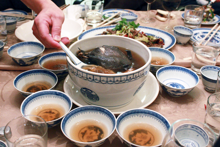Serving Wisconsin Ginseng and Silky Chicken Soup