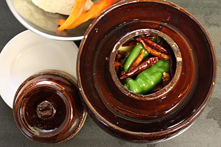 Filling up a Chinese pickle jar