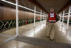 Red Cross worker, Sam, cleans and organizes cots at the Silver Dollar Fairgrounds shelter in Chico, CA, where he is the shelter manager. Photo: Marko Kokic, American Red Cross