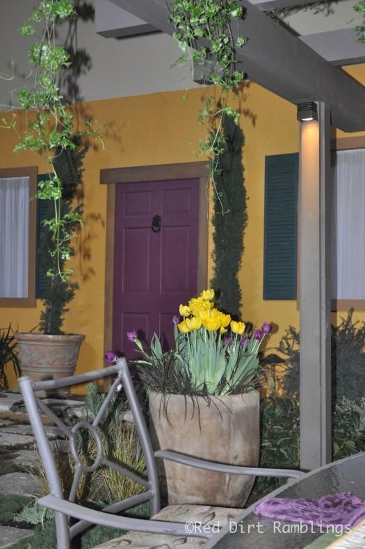 A doorway in a garden.