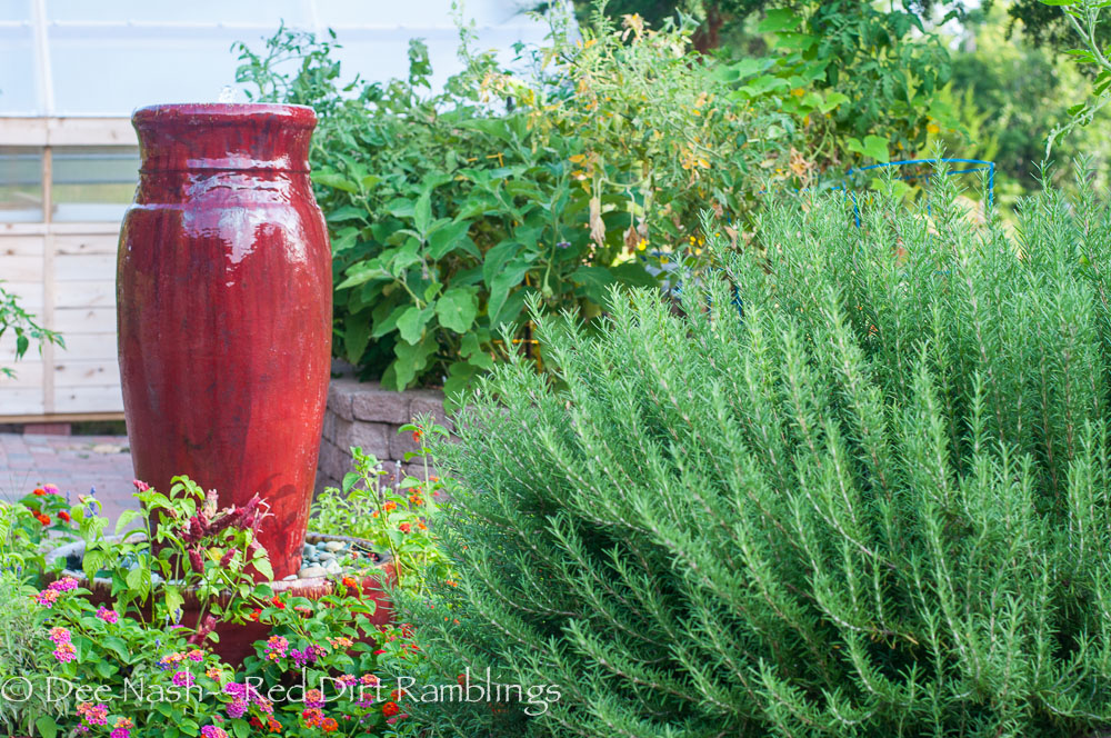 Red fountain in the potager; garden in my mind