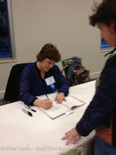 Signing books at the Northwest Flower and Garden Show.
