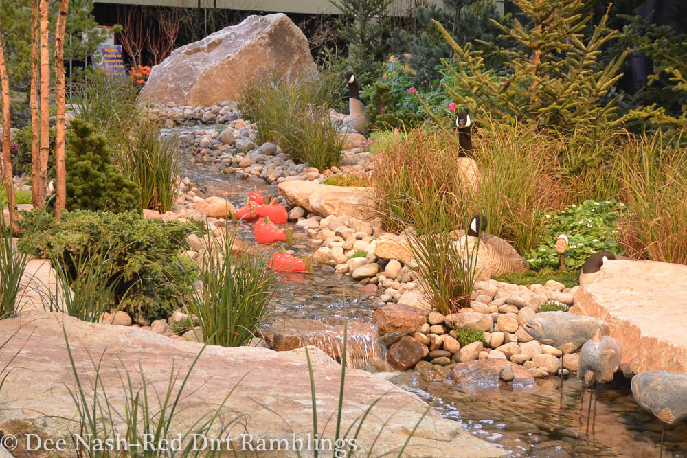 Notice the blown glass salmon swimming upstream in this garden called Discovering Alaska at the Northwest Flower and Garden Show.