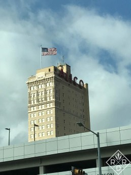 Waco's famouse Alico building against a cloudy Texas sky.