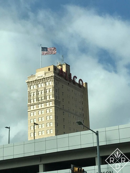 Waco's famouse Alico building against a cloudy Texas sky.