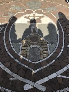 Crest of the Portiuncula in the courtyard of St. Mary of the Angles.