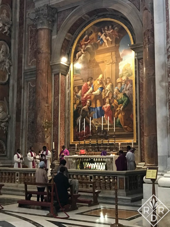 Celebrating mass at one of many altars in St. Peter's Basilica.