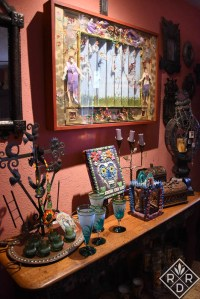 Check out the agave glasses on this little bar or altar in Lucinda's living room. I love those!