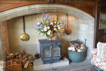 The gracious fireplace with flowers from Pamela's garden. She likes to grow flowers to bring indoors.