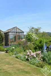 Greenhouse and Herbaceous Border at Low Hall.
