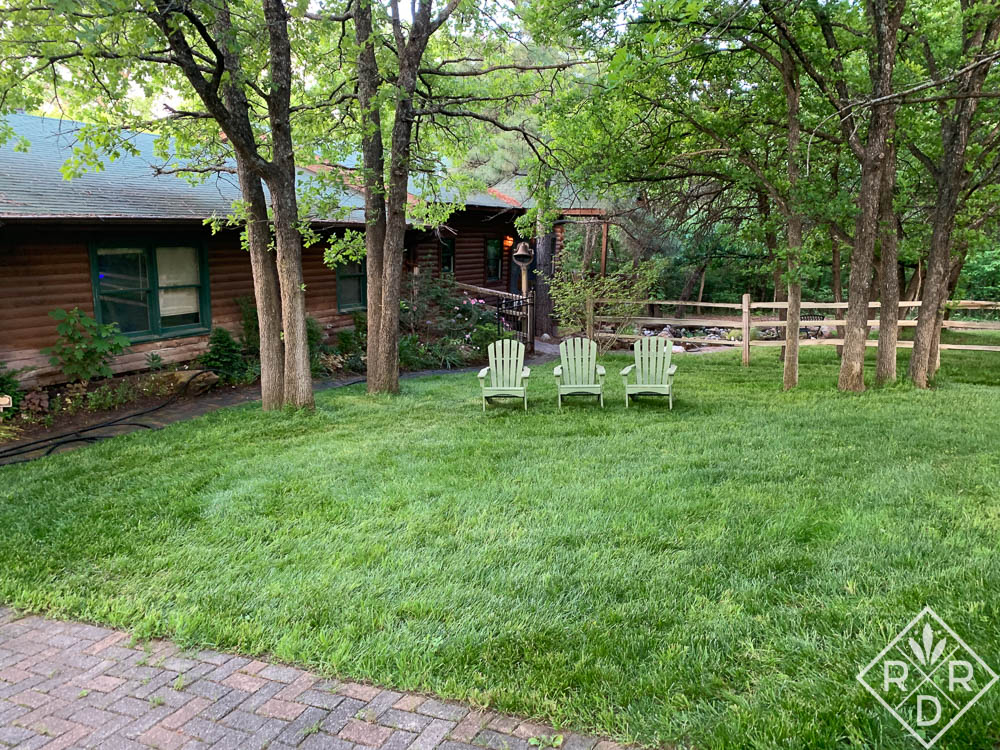The green chairs in the front fescue lawn.