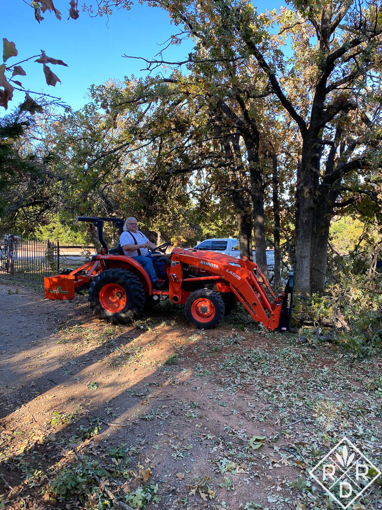 Bill picking up a load of tree branches on the tractor.