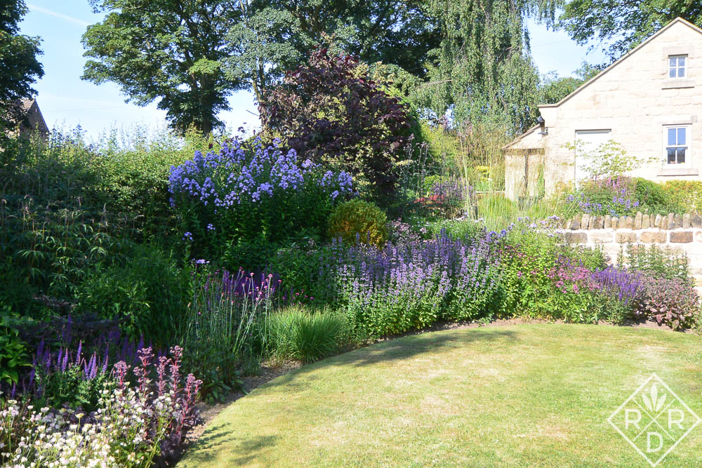 Herbaceous border and one side of the Cow Close Cottage.