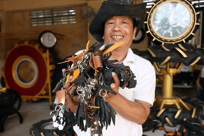 Nguyen Van Phung with his collection of products made from scrap tires. Photo courtesy of the Vietnam Book of Records.