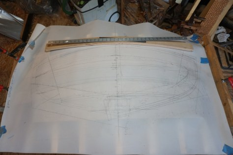 Here the transom planks are being developed from the lofting. This drawing shows the internal framing and planking shapes.