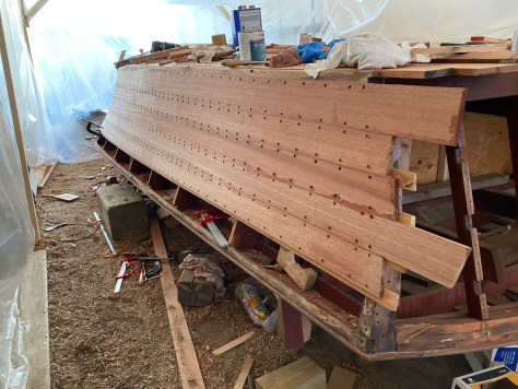 Topsides aft planks left long to be trimmed when applying the transom planks to the stern.