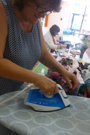 Di was cutting strips from scraps for a new masterpiece