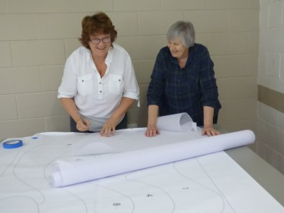 Di and helen cutting out the stabiliser for the challenge pieces