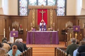 Celebrant at the altar