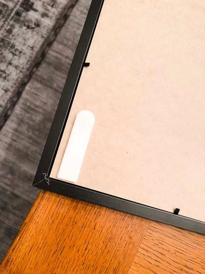 Command Strip on Frame