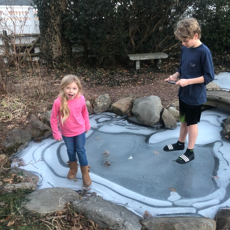 kids on frozen koi pond