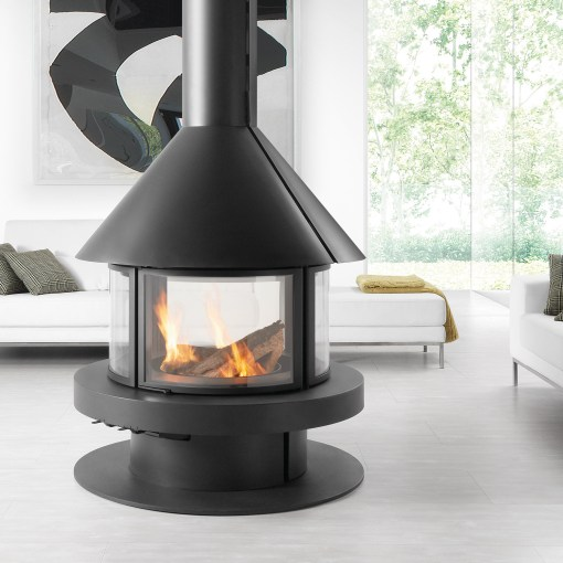 Round central stove with 4 curved glass doors.
